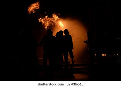 silhouette fire fighter at night.