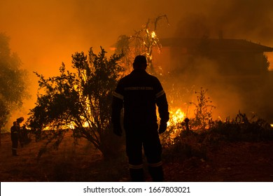 Silhouette of a firefighter during the operations of the Greek Fire Department to fight the wildfire in the village Kontodespoti Evia, Greece on 13 August, 2019