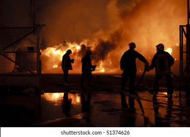Silhouette of firefighters