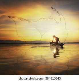 Silhouette Fisherman in action fishing .