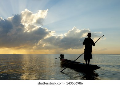 Silhouette of a fisherman with beautiful sky.