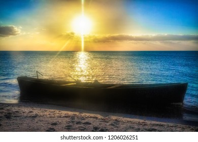 Silhouette of fisherman boat in a golden sunset in the inhabited 'White Key'. The beautiful Cuban place is located South of the small Tunas de Zaza town.