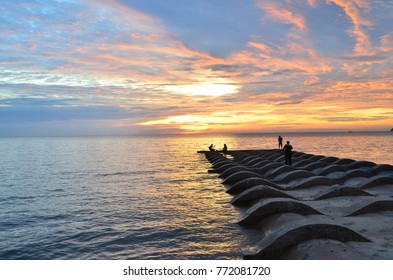 Silhouette of fisherman during sunset