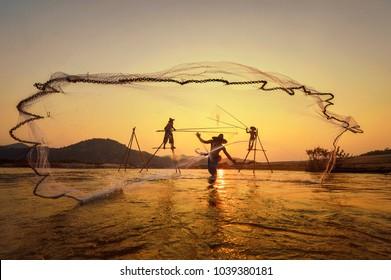 Silhouette Fisherman Fishing Nets .Thailand