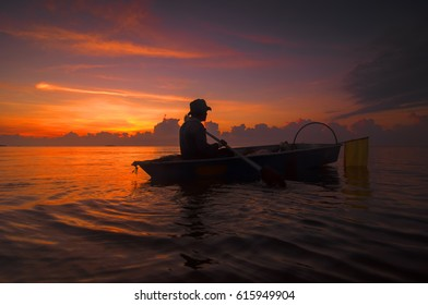 Silhouette of Fisherman Going to Work at Sunrise