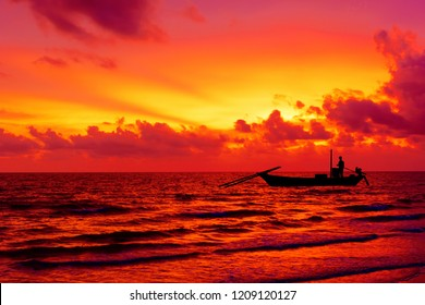 Silhouette fisherman on the boat over sea and clouds at sunset time. Can used for loney concept or people with nature background.