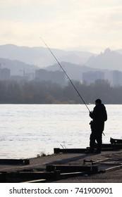 silhouette-fisherman-on-city-promenade-2