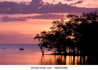 silhouette fisherman at sunset