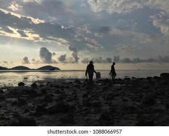 A silhouette of a fisherman,Fishermen collecting shellfish on the beach