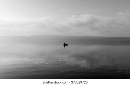 Silhouette of a fisherman's boat at lake