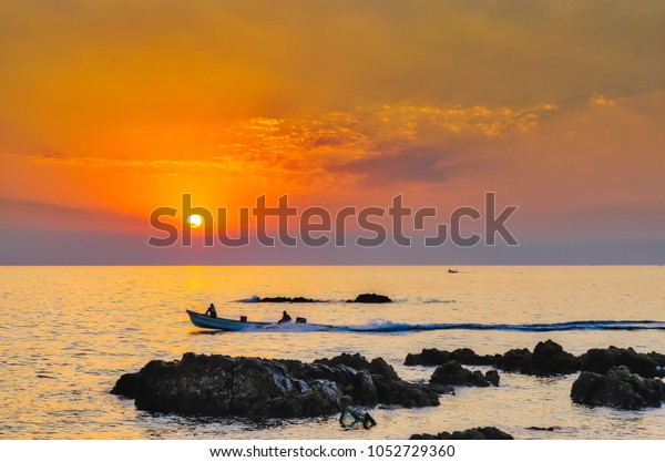 silhouette-fishermen-boat-going-fishing-