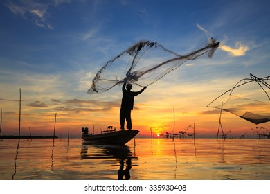 Silhouette of fishermen at talay noi, Pattalung Province, South of Thailand