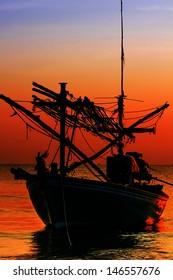 Silhouette Fishing Boat on sunset  a background of  beautiful sunset