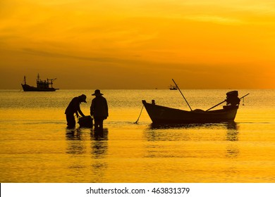 Silhouette of fishing and fisherman boat at the Sunrise in thailand