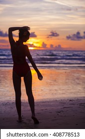 silhouette of fit woman in bikini at sunset, remote tropical beaches and countries. travel concept