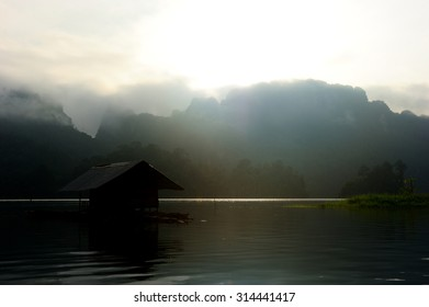 Silhouette of the floating bamboo hut in the lake of Ratchaprapha dam, Khao Sok national park, Suratthani