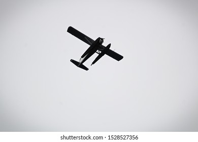 Silhouette of a floatplane underside against a grey background