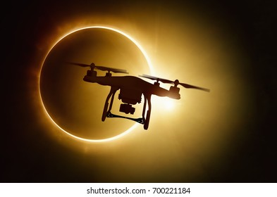 Silhouette of flying drone on total solar eclipse background