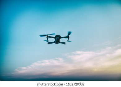 Silhouette of flying drone sunset sky