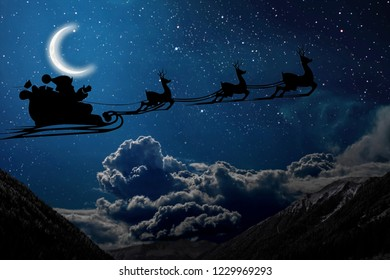silhouette of a flying goth santa claus against the background of the christmas night sky. Elements of this image furnished by NASA