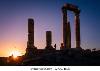 Silhouette of flying kites at the Temple of Hercules against clear sunset, Amman Citadel, Amman, Jordan