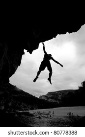silhouette of free climber falling in water