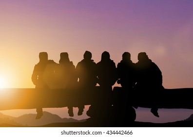 Silhouette friends imaging touch cold on the mountain peaks in winter. Dear friend, do not leave each other. Concept friends Party. The coalition parties in the holiday New Year. Day thanks to God