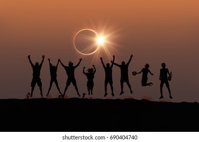 "Silhouette of friends jumping at Solar Eclipse ""Elements of this image furnished by NASA """