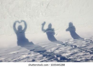 Silhouette of friends taking selfie photo in winter travel.