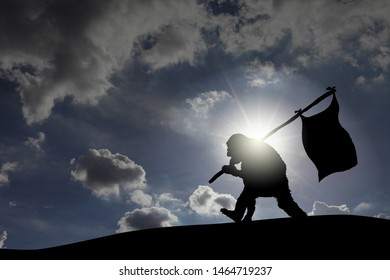 Silhouette of a furry monkey marching over a hill with a flag pole against a surreal cloudy sky.