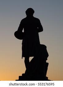 Silhouette of the Gainsborough statue in Sudbury, Suffolk