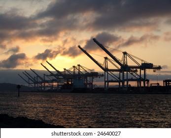 silhouette of Gantry Cranes at dusk, Oakland, California, USA