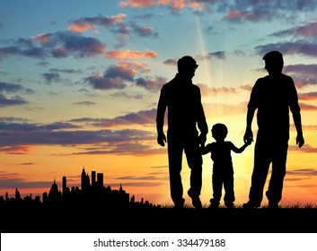 Silhouette of gay parents with a child for a walk on the background of the city away