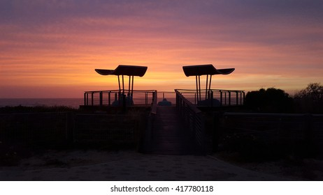Silhouette gazebo at sunset background