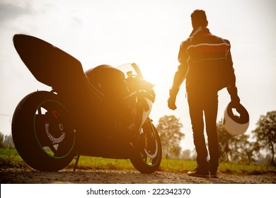 silhouette of a generic sport motorbike and biker. concept of people, transportation