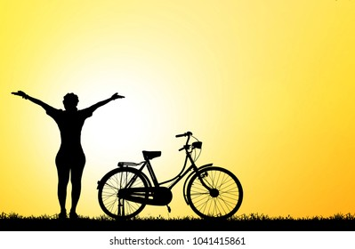 silhouette girl with a bicycle on blurry sunrise background.