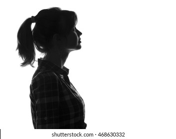 silhouette girl face looking up on white isolated background, woman profile