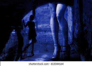 Silhouette of a girl and female leg on a background of a dark city street (double exposure)