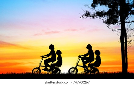 silhouette   girl group  riding bicycle