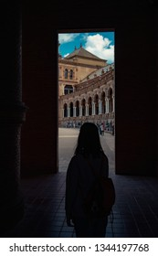 Silhouette girl in a historic touristic place at her travel. Backpack travel concept.