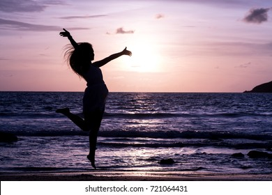 silhouette girl jump on the beach, twilight, concept black body, copy space.