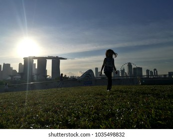 Silhouette girl in marina barrage singapore , marina barrage is rooftop park for rest
