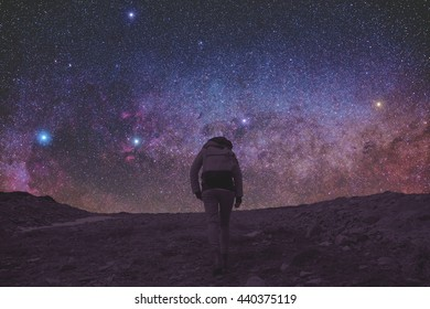Silhouette of a girl and mountain with milky way. No elements of NASA or other third party.