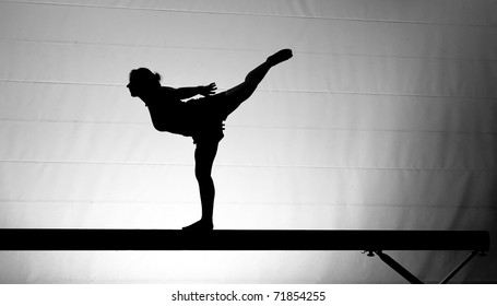 silhouette of girl on balance beam