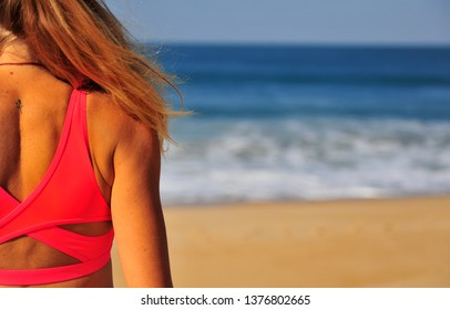 Silhouette of a girl on the sand beach