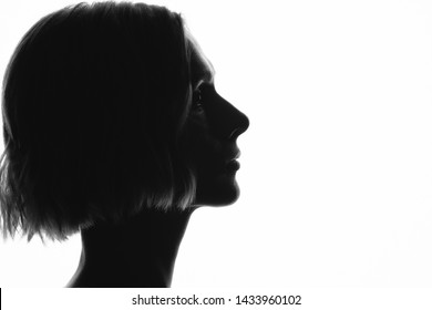 silhouette of girl in profile on white background
