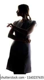 silhouette of a girl who stands in a pensive posture