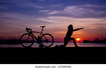 silhouette of girl Yoga with bicycle.