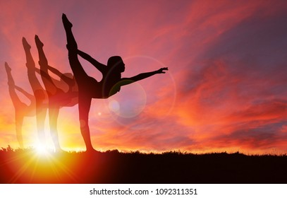 Silhouette of girls dancing or exercising with vibrant golden sunrise or sunset background and copy space. Concept of healthy living, exercising, celebration or jubilant mood.