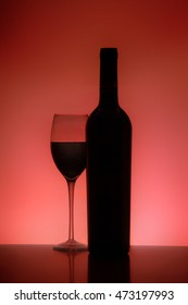 Silhouette of a glass and Bottle of red wine